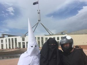Men in KKK hood, helmet and burqa walk into Parliament...