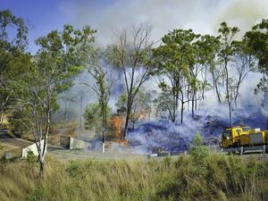 Firies save homes as 'wall of flame' nears