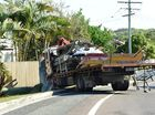 Scene of a single vehicle crash on David Low Way, Yaroomba, where a truck carrying scaffolding left the road and crashed into a telegraph pole, bringing down power lines. Photo: Iain Curry / Sunshine Coast Daily