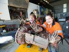 GREASE MONKEYS: Busways' female mechanics Melinda Crampton, left, and Amber Cook.