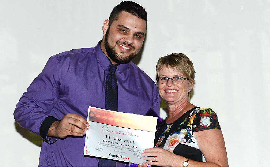 RUNNER-UP: The Royal Hotel's Murray Benton accepts the award from The Gympie Time's Tracey McKean.