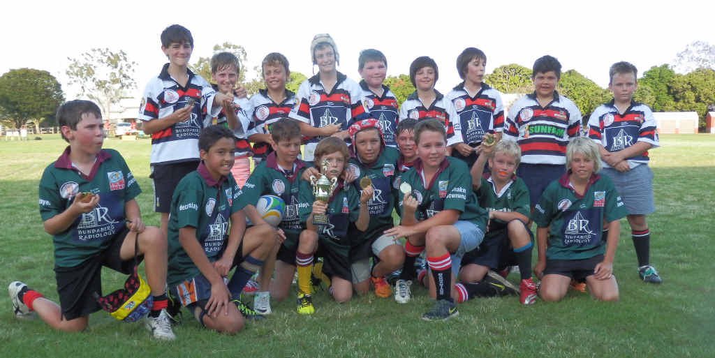 SKILFUL DISPLAY: Isis Cutters and Bundy Barbarians with their medals after the Crushers Cup.
