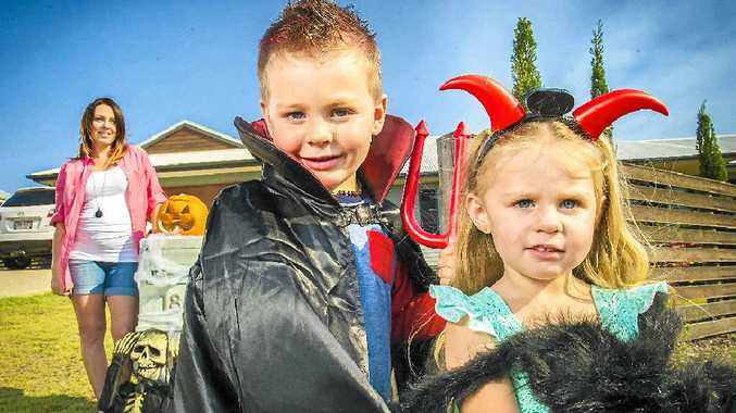 SCARE FACTOR: Blake Brown, 5, and Isabella, 3, get excited about Halloween with their mum Alyce Shields.