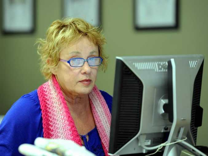Toni McRae at work in the Chronicle office.