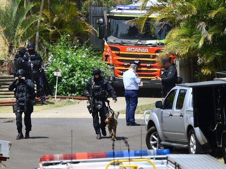 SERT officers and police respond to a siege situation at Collingwood Park after a man allegedly attacked a police officer with a machete. Photo: David Nielsen / The Queensland Times