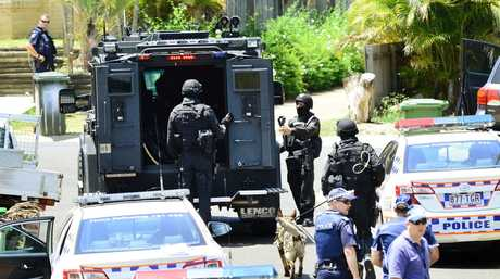 The SERT unit and police respond to a siege situation at Collingwood Park after a man allegedly attacked a police officer with a machete. Photo: David Nielsen / The Queensland Times