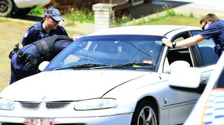 Police confiscate a phone from the passenger of this vehicle who was in contact with the man involved in a siege situation at Collingwood Park after a man allegedly attacked a police officer with a machete. Photo: David Nielsen / The Queensland Times