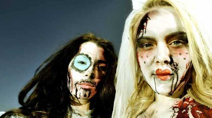WHAT A FRIGHT: TAFE make-up students Renee Dale and Mikaela Luck get into the spirit of Halloween as part of their course.