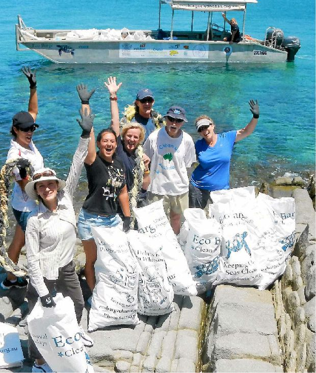 MILESTONE TRIP: Eco Barge Clean Seas celebrated its 150th clean-up trip to the Whitsunday islands on Monday. Pictured are: Andrea Scharneck, Simona Paganetto, Savina Cornacchia, Ninni Tarrant, David Young, Tony Dunn, Skye Briggs and Libby Edge on the Eco Barge.