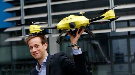 "Alec Momont, 23, with his ""ambulance drone"" designed to save lives by reducing response times to medical emergencies."
