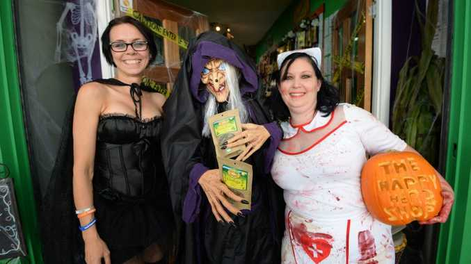 Joby Finlay and Nik Kendall from the Happy Herb Shop are celebrating Haloween. Photo: Chris Ison / The Morning Bulletin