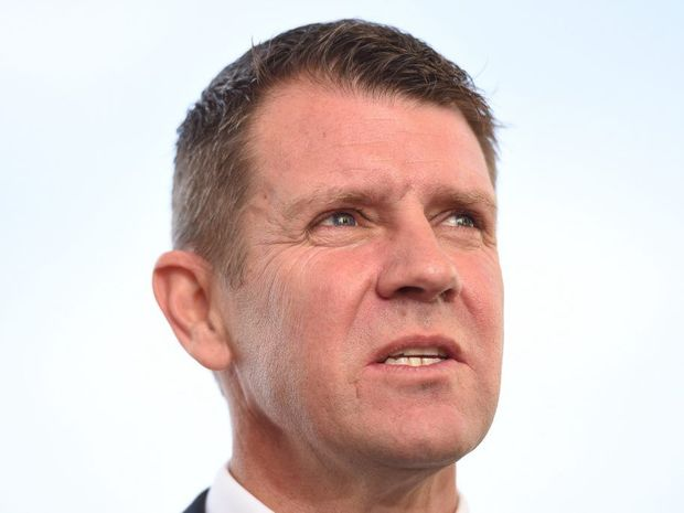 New South Wales Premier Mike Baird speaks to the media as he arrives at Parliament House in Canberra, Friday, Oct. 10, 2014. State and Territory leaders are today in Canberra for the 38th Council of Australian Governments (COAG) meeting. (AAP Image/Lukas Coch) NO ARCHIVING