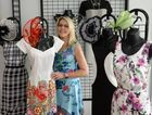 FASHIONS ON THE FIELD: Hotline Boutique owner Kaye McCotter with number of gorgeous outfits for Melbourne Cup race day. Photo: Mike Knott / NewsMail