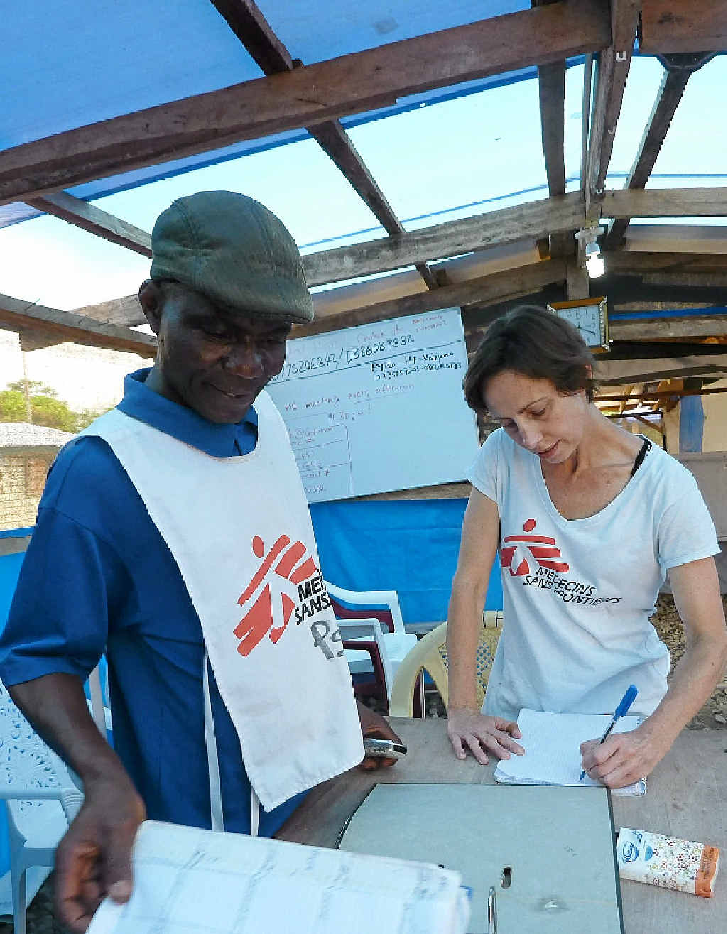 FRONT LINE: Former Ballina resident and epidemiologist Barbara Telfer is working to fight the outbreak of Ebola in West Africa as part of Doctors Without Borders. INSET: A medical worker spraying people being discharged from the Ebola treatment centre in Liberia.