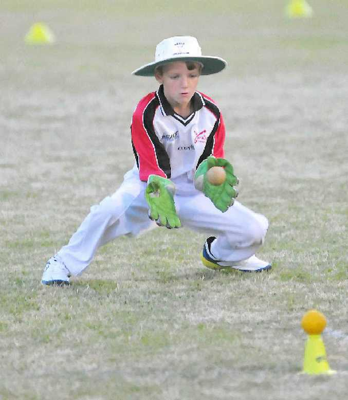 Kayne Bartlett plays for keeps in under-10 cricket action.