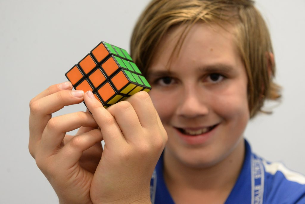 PROBLEM SOLVING: Luke Turnbull with the Rubik's Cube. Photo: Mike Knott / NewsMail