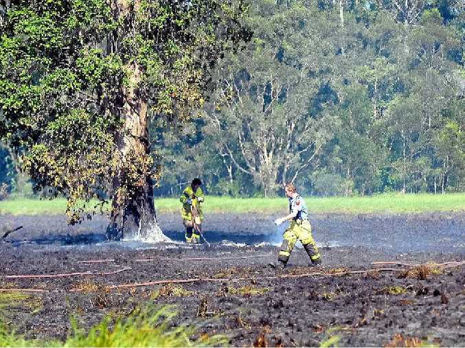 Firefighters clean up after extinguishing a blaze at Meridan Plains.