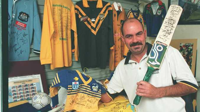 10/07/01 99336 Champion Sporting Charity Fund Raiser Neil Espley with some of his Memorabilia. sign0