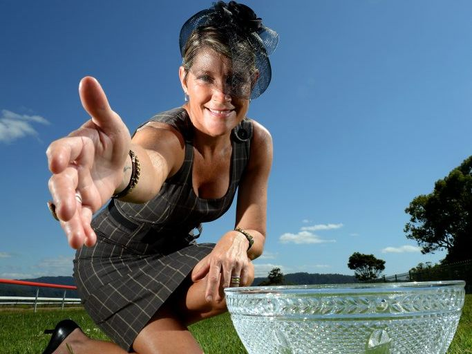 Jane Rennie-Hynes with the Ellis + Baxter solicitors and Attorneys cup. Photo: John Gass / Tweed Daily News