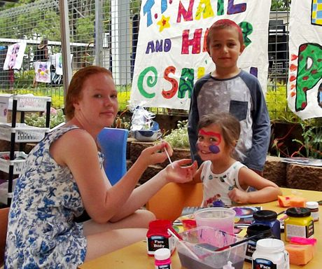 Teven-Tintenbar Public School s 20th Annual Country Fair on Saturday. James Muldoon (standing) looks on as his sister, Poppi has her face pained by Laura McLachlan.
