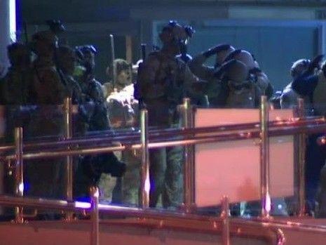 Soldiers fine tune their G20 preparations in Brisbane's CBD on Sunday night. Photo: Nine News