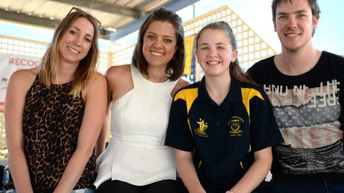 Kaylee Harrison, Amber Lawrence and Glen Harrison with St Anthony's Catholic Primary School student Sophie Fletchett at a free school concert on Friday. Photo Allan Reinikka / The Morning Bulletin