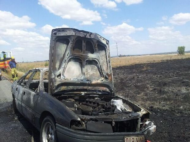 The burnt out remains of a Holden about 40kms from Dalby that caught fire about 12.15pm.
