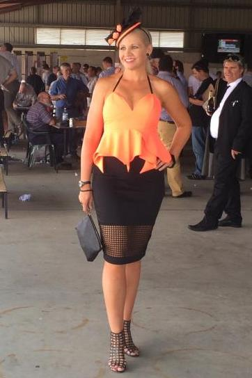 Melanie Dyball shows off her outfit at the Gladstone Turf Club for Melbourne Cup Day.