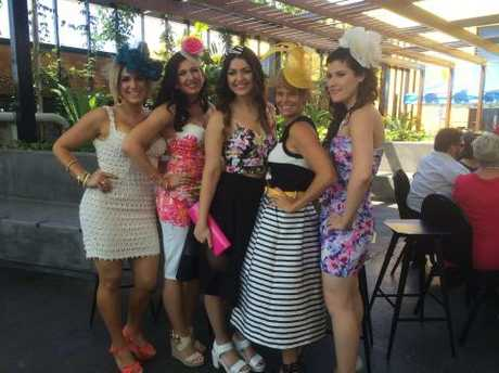 The fashionable crowd at the Gladstone Entertainment Centre for Melbourne Cup Day.