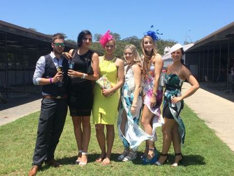 Some of the well-dressed people at the Gladstone race track for Melbourne Cup Day racing.