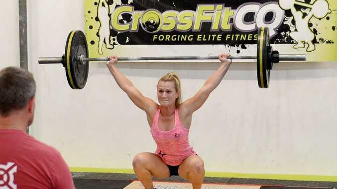 Meagan Murphy snatching 50kg. Photo Allan Reinikka / The Morning Bulletin