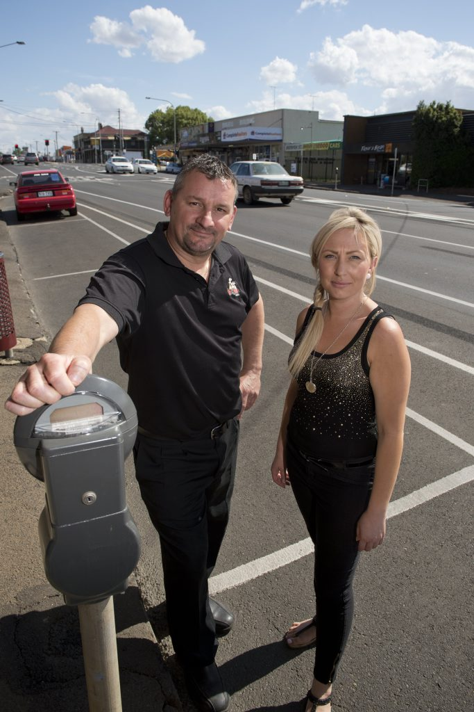 Ruthven St business owners Paul Worrall and Leanne White stand near the bike lane which has meant the loss of parking spaces.