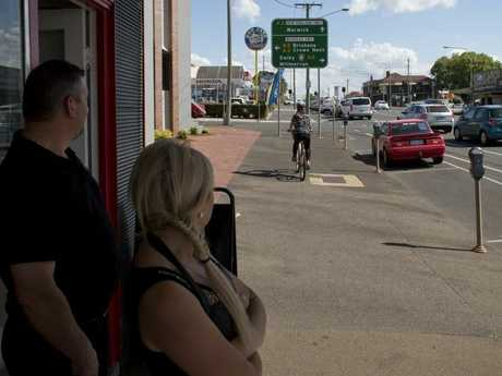 Ruthven St business owners Paul Worrall and Leanne White watch as a cyclist uses the footpath instead of the bike lane which has meant the loss of parking spaces.