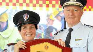 FIRE AWARD: Bangalow Fire Brigade deputy captain Mellissa Madden and FRNSW Commissioner Greg Mullins.