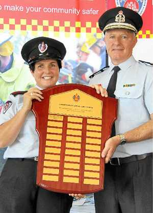 FIRE AWARD: Bangalow Fire Brigade deputy captain Mellissa Madden and FRNSW Commissioner Greg Mullins.