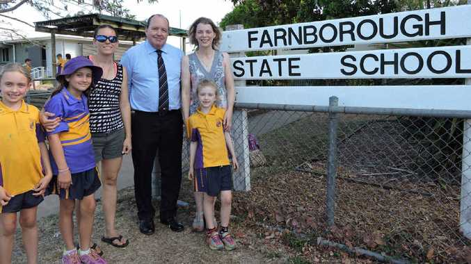 PETITION: Leisa McDowell, with daughters Nahoya and Akita, Keppel MP Bruce Young and P&C; committee member Lee-Ann Lovegrove, with daughter Sienna, are excited about a petition for a parking upgrade at the school.