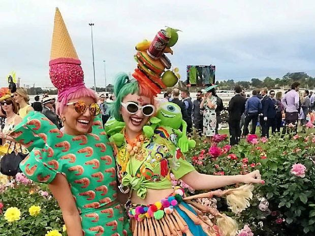 JUST PEACHY: Anna and Amelia Vivash turn heads at the 2014 Melbourne Cup