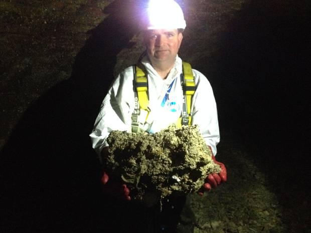 British sewer worker Tim Henderson holding a fatberg