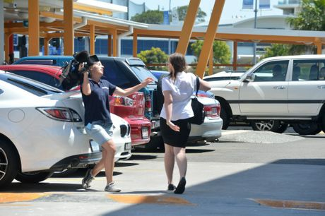 A scuffle outside Maroochydore Court involving the camera operator from WIN TV. Photo: Warren Lynam / Sunshine Coast Daily