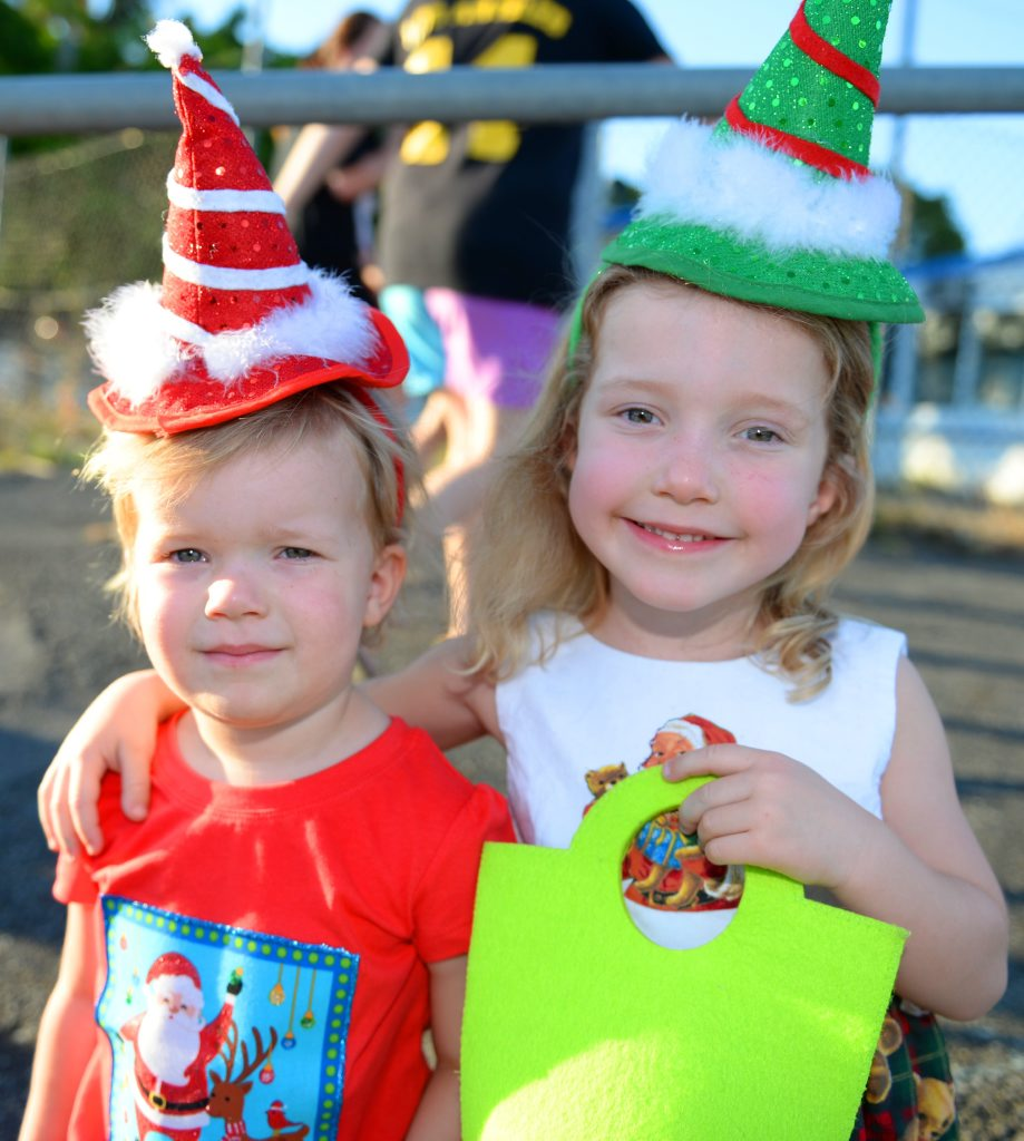 Indie (2) and Ella (4) Spring at the 2014 Stockland Christmas Parade in Rockhampton. Photo: Chris Ison / The Morning Bulletin
