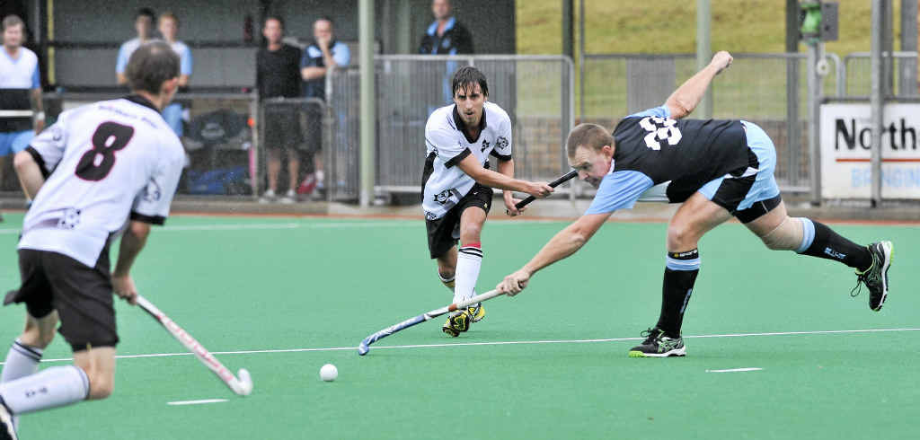 MASTER IN ACTION: Brett Crawford (blue shirt) in action for Ballina. Crawford is one of seven players selected in Australian Hockey Masters teams to play New Zealand next year.