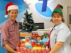 JOLLY SPIRITS: Telstra Whitsunday manager Ryan Langford and The Rotary Club of Airlie Beach secretary Denise Norder are accepting donations for Christmas hampers now.