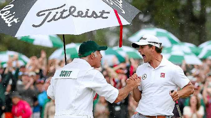 Caddie Steve Williams and Adam Scott celebrate Scott's victory at the 2013 Masters.