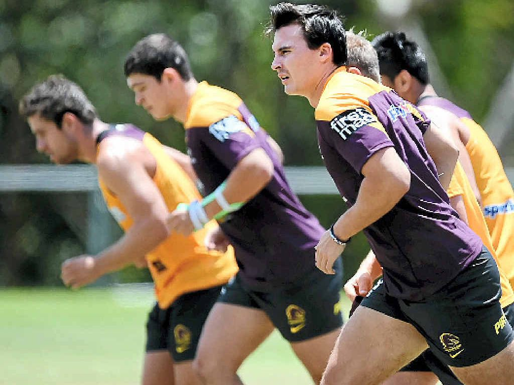Brisbane Broncos players run during a fitness test in Brisbane yesterday.
