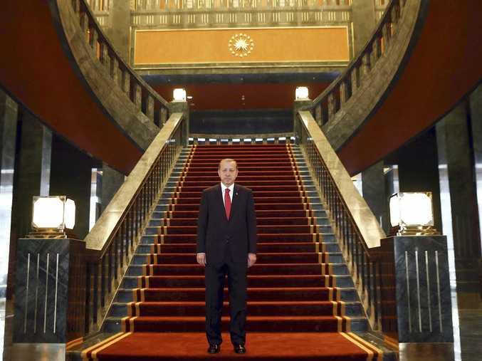 Turkish President Recep Tayyip Erdogan poses inside the new Ak Saray presidential palace (White Palace) on the outskirts of Ankara