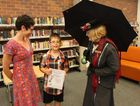 Luise Straker, Bailey Frampton and Mary Poppins, also known as Carmel Murdoch, at the Proud Marys 15th Maryborough children's fantasy writing awards presentation.