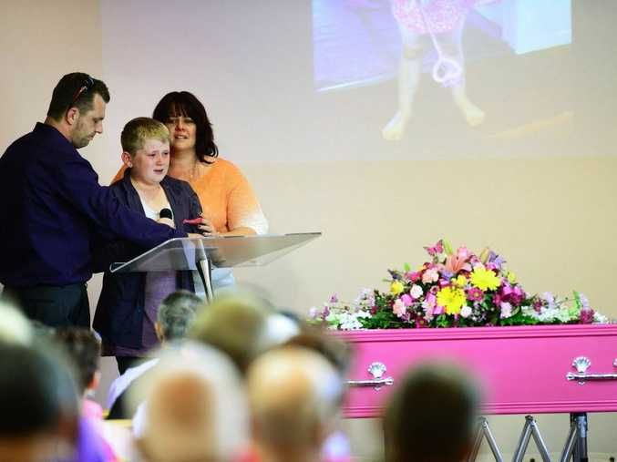 Funeral service for Charlee Ferrar at the Fassifern Christian Church in Kalbar. Charlee's cousin Jake Reeve (12) with his mother Casey Stewart and step-father Trevor Stewart.