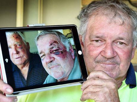 Bashing victim Graham Law with a photo of himself and his brother-in-law Terry White after they were bashed at a Brisbane hotel.