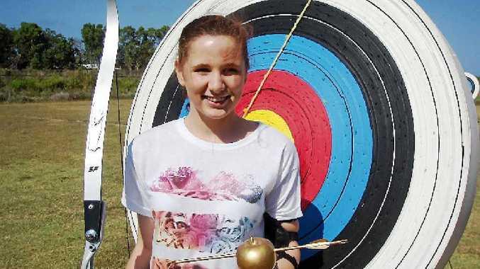 Katie De Battista holds her Golden Arrow trophy after Mackay PCYC's first open archery tournament.