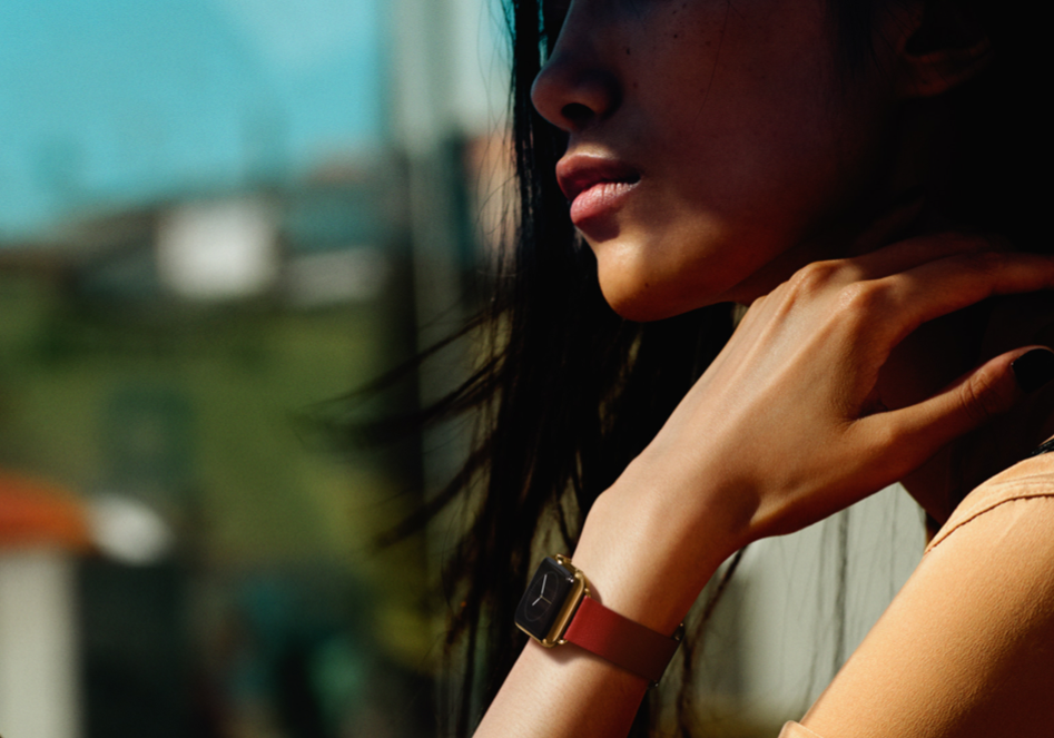 A model, shown on Apple's website, wears a 18-karat yellow gold Apple Watch.